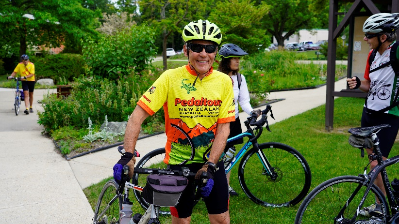 A group of people riding bikes  Description automatically generated with medium confidence